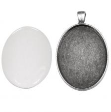 Colgante camafeo metálico con cabuchón vidrio. 3,2x4,2 cm. Oro y plata
